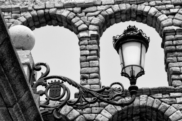 Lamp Framed in Acueducto Arch - Segovia, Spain - Copyright 2012 Ralph Velasco