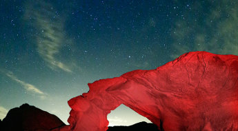 For this image at Valley of Fire in Nevada, the arch made for the perfect foreground. But it was silhouetted against the night sky. Using an LED headlamp and a warming filter, I was able to illuminate the red rocks and balance that illumination with the ambient exposure for the night sky. This image was taken with the EOS 5D Mark III with EF 8-15mm Fisheye Zoom. Exposure was 15 seconds, ISO 6400 at f/4.