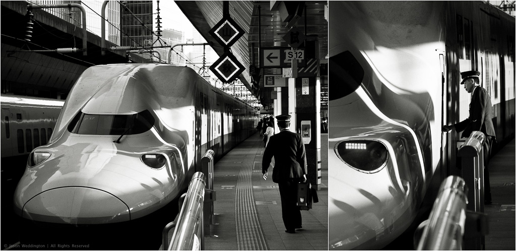 Train conductor walking to a Japanese Bullet train in Tokyo Station, Japan