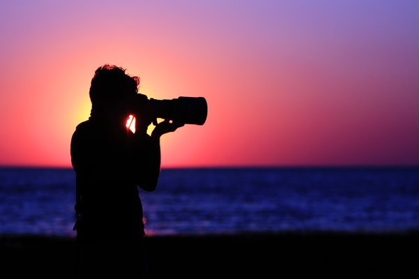 As the sun set on Massachusetts Bay, I turned and saw my buddy Joe lining up a shot. I walked around him until the sun was directly behind his head, and dialed my exposure way back to -2 stops to create the sihouette. Canon EOS 50D, EF 70-200 f/2.8L IS USM. ISO 100, 1/6400, f/2.8. Shot in Av mode at -2 exposure compensation.