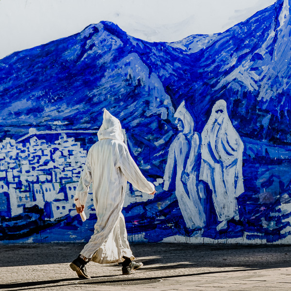 Chefchaouen, Morocco. I wanted to portray someone wearing the same outfit as the people in the painting, so I waited until the perfect subject passed by.
