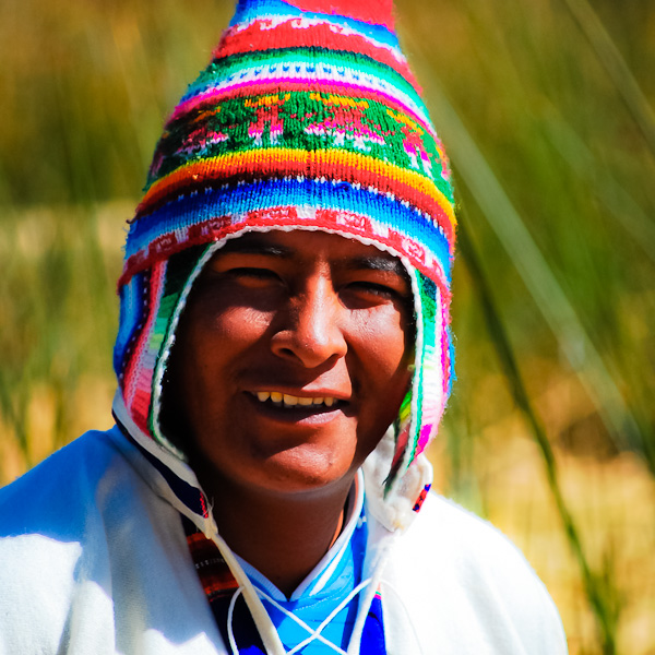 "Peruvian man. ""Can I take your picture?"". ""It's my pleasure!""."