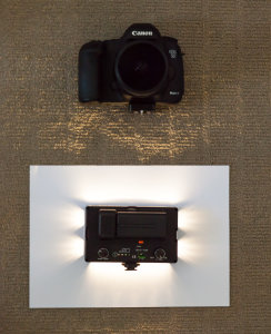 A recreation (in my office) of the setup I used. The video light is pointing straight down into the paper.
