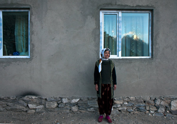 -Tajikistan- Canon EFS 17-55mm f/2.8 Fstop of 5.6, shutter speed@1\100 and ISO 100 Natural light (sunrise) reflecting from the mountains, which are about 45 degrees to the woman (you can see it in the window).