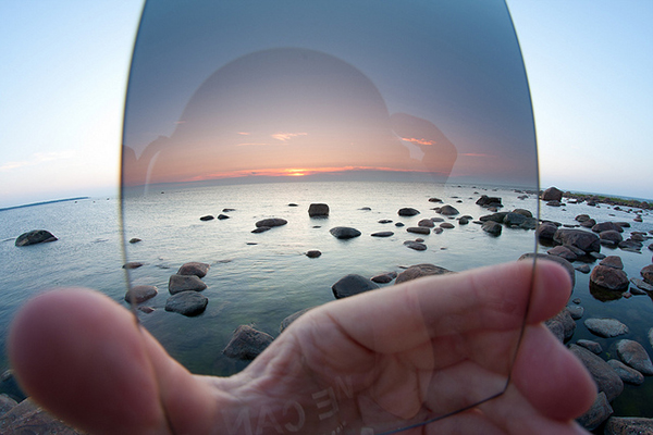 A wide view of a hand-held graduated neutral density filter illustrates how valuable it is to capturing accurate colors in landscape photography.