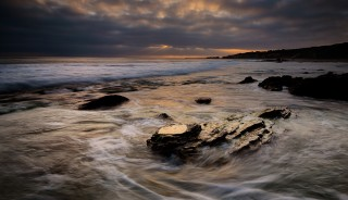 As the sun was setting on Pelican Point in Laguna, the tide rushed around this set of rocks. EOS 5D Mark III with EF 24-70 f/2.8L II. .8 seconds, f/11, ISO 400.