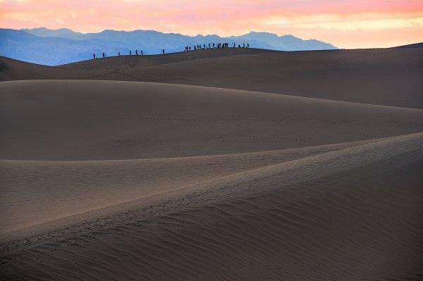 Workshop students set up for sunrise at the Mesquite Flat Sand Dunes