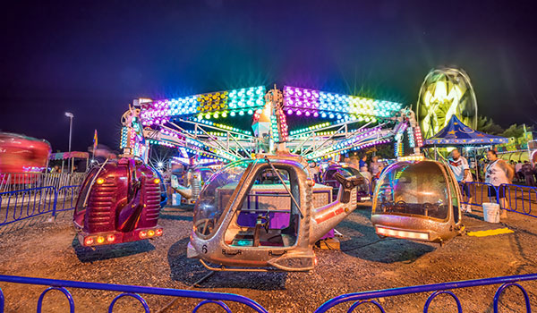 Learn how to photograph the fairground at night