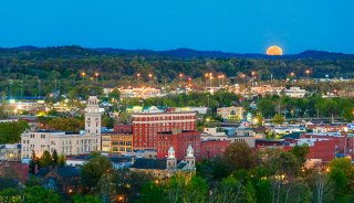 "Here the April moon called the ""Pink Moon"" rose over Marietta, Ohio. The setting sun lit the city in a warm glow."