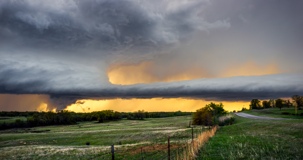 I haven't photographed a tornado yet, but this is about as close as I've come. This wall cloud (the section of a storm where tornadoes DO come from) began lowering behind the tree line while rotating quite rapidly. © James Brandon