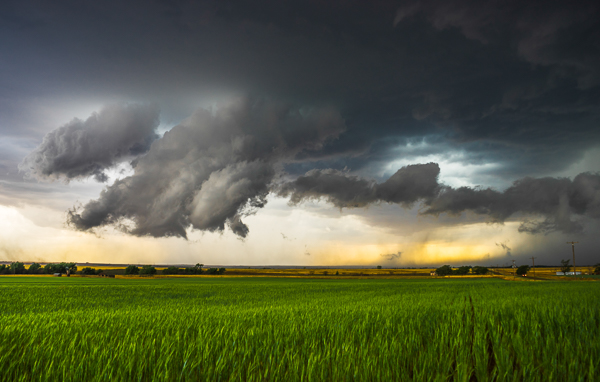 This image shows an area of outflow from the storm that was moving off to the right. At one point the cloud began to resemble a funnel that was almost touching the ground. However, it wasn't rotating and it was on the wrong part of the storm. A few minutes later, tornado sirens began going off in the small town nearby, even though the storm wasn't tornado warned yet. Someone had called in and said a tornado was on the ground.