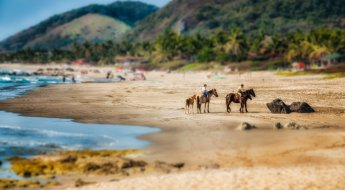 Tilt-shift effect applied to a beach scene.