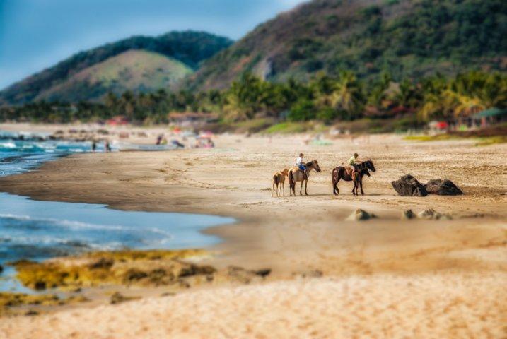 Tilt-shift effect applied to a beach scene.
