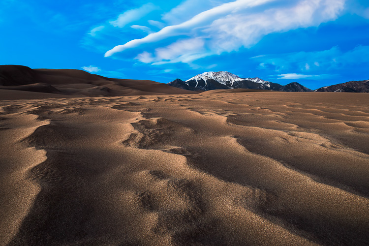 Two image focus stack at Great Sand Dunes National Park in Colorado. One for the sand that was less than a foot from the lens, and one for the background.