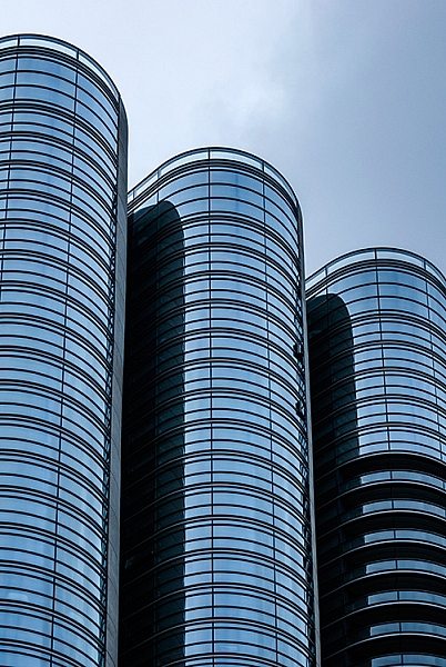 The curved shapes of the glass buildings gives a great sense of rhythm
