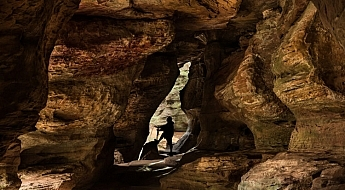 In this image of Rock House in Hocking Hills State Park in Logan Ohio adding the Silhouetted figure at the end of the cave adds a sense of scale and also adds a focal point to the image.