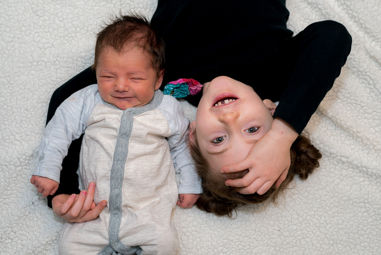 relaxing-for-portrait-session-baby-sister