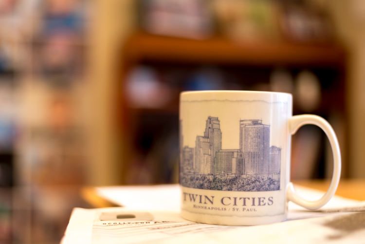 To put my money where my mouth is, I took my camera to work and literally snapped a picture of a coffee cup on my desk. No photoshopping or magic tricks here, just a wide f/1.8 aperture. 50mm, 1/100 second, ISO 160