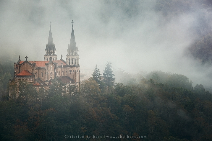 Foggy sunrise at Covadonga cathedral in Asturias, Spain