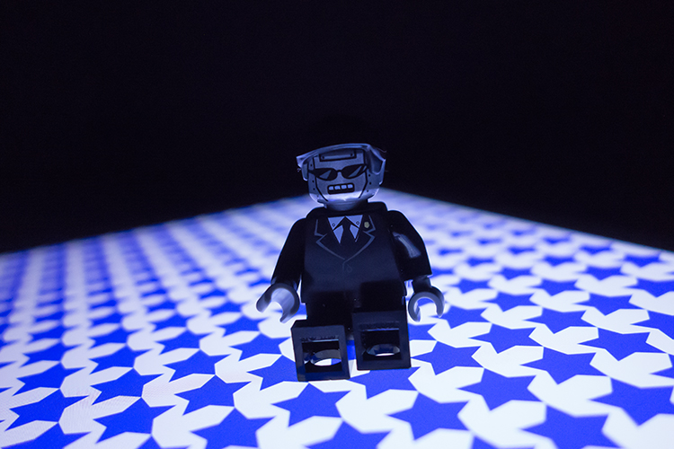 lego-figure-blue-stars-background