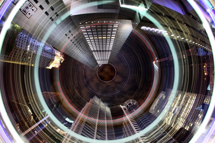 The CBD area of Singapore has many locations where a worms eye view looks good. The light rotation adds an extra element to this photo.