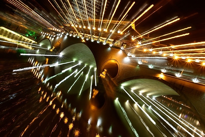 The bridge lit with many lights is a good subject for a zoom burst.