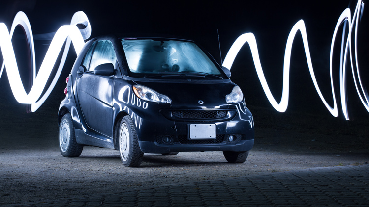 A light painted car with light trails